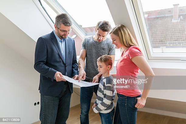 Estate agent explaining family construction plan of a penthouse