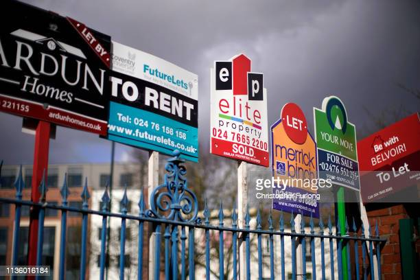 Estate agent For Sale and To Let signs adorn a fence next to houses on March 14 2019 in Coventry England
