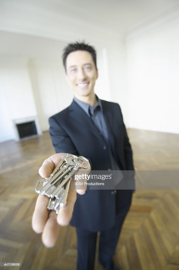 Estate Agent Holding Keys : Stock Photo