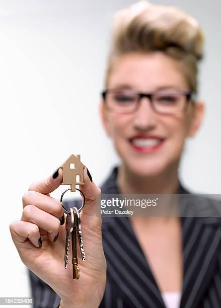 Estate agent holding new house keys