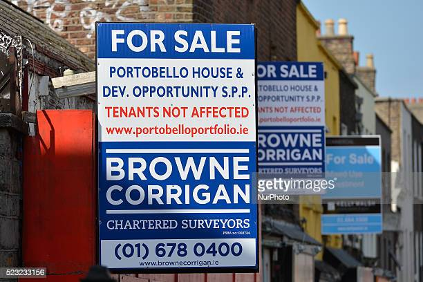 Estate agent signs advertising houses and businesses for sale near Portobello bridge area as more and more signs can be seen around Dublin bringing...
