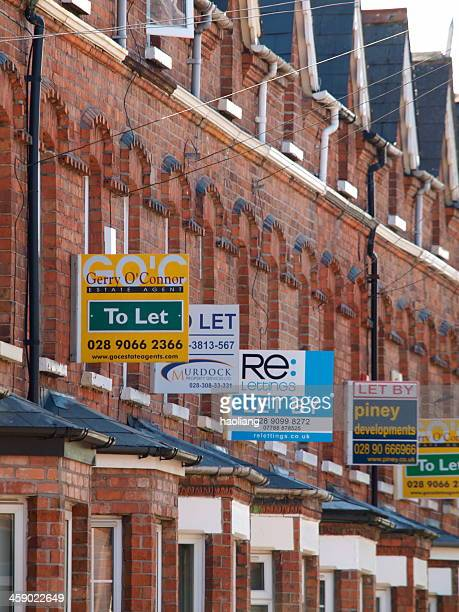estate agent signs on old house - house rental stock photos and pictures