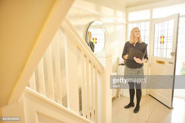 estate agent surveying a house