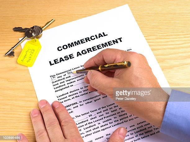 estate agent writing commercial lease - lease agreement stock pictures, royalty-free photos & images