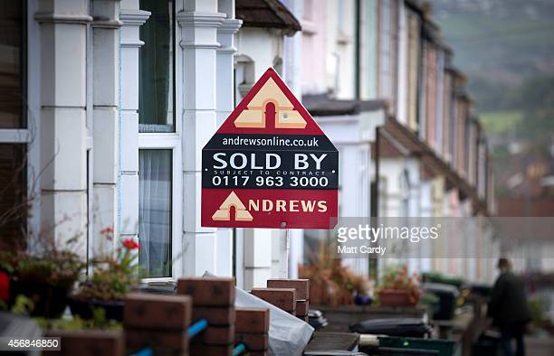 A estate agent's board is seen outside a property on October 8 2014 in Bristol England On the first anniversary of the introduction of second phase...