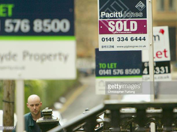 Estate Agents boards stand outside properties for sale March 16 in Glasgow Scotland The Chancellor Gordon Brown is widely expected to take measures...