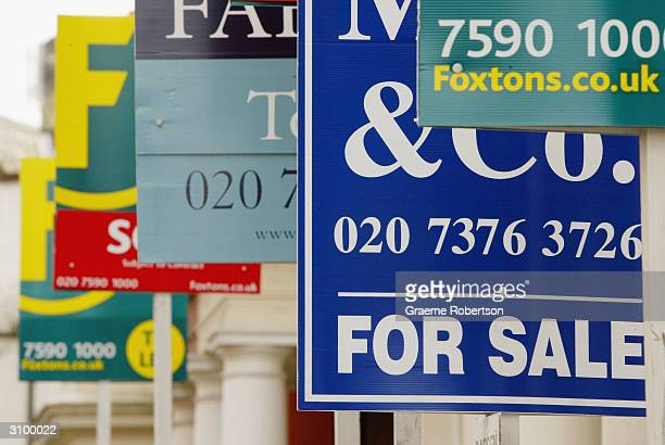 Estate Agents boards stand outside propertys for sale March 16 2004 in London England The Chancellor Gordon Brown is widely expected to take measures...
