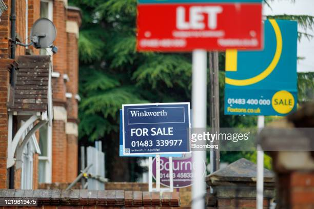Estate agents for Sale and letting signs stand outside properties in Guildford, U.K., on Friday, June 12, 2020. U.K.House pricesfell the most in...