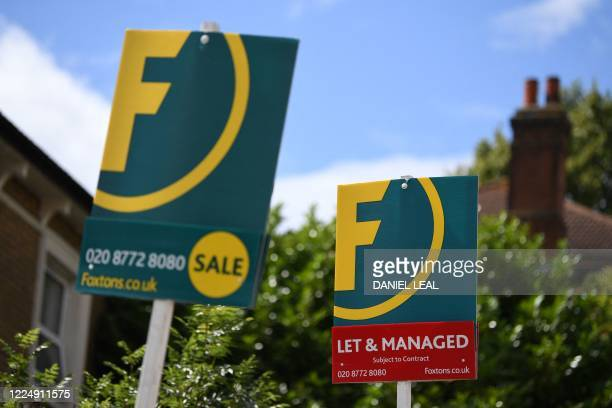 """Estate Agents' """"For Sale"""", and """" To-Let"""" boards are pictured outside residential properties in south London on July 6, 2020. - British media reported..."""