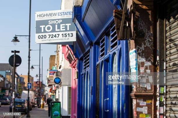 A estate agents' letting sign board stands in front of a shop for rent on Roman Road in London UK on Friday March 27 2020 UK house sales are set to...