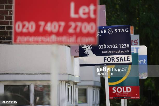 Estate agents placards are seen in front of houses in London on August 17 2016 From computers and cars to carpets and food Britain's decision to...
