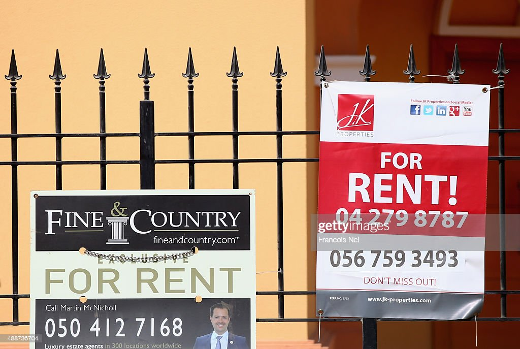 Estate agents rental signs stand outside a villa in Jumeirah Park on