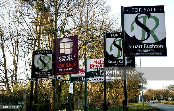 Estate agents signs advertising residential properties 'For Sale' and 'To Let' are seen in Mere UK on Thursday Feb 23 2012 UK house prices held their...