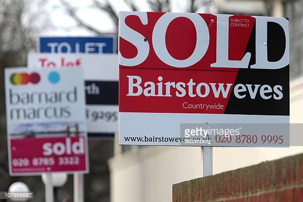 Estate agents signs advertising residential properties sold and to let stand in Putney South London UK on Monday Jan10 2011 UK house prices fell the...