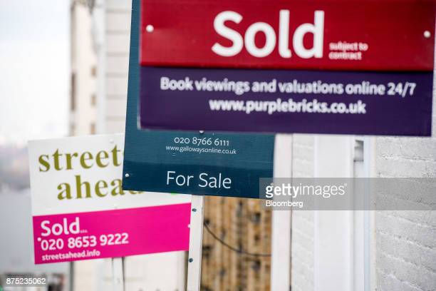 Estate agents 'Sold' and 'For Sale' boards stand outside residential properties in London UK on Thursday Nov 16 2017 London's housing market is being...