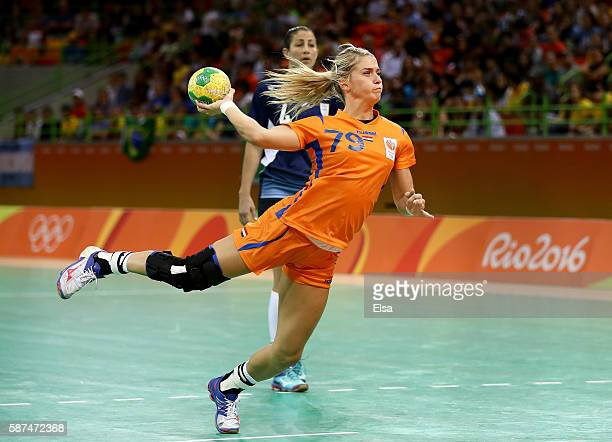 Estavana Polman of Netherlands takes a shot as Lucia Haro of Argentina defends on Day 3 of the Rio 2016 Olympic Games at the Future Arena on August...