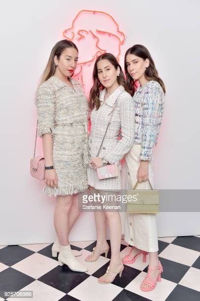 Este Haim, Alana Haim aand Danielle Haim of HAIM , all wearing Chanel, attend a Chanel Party to celebrate the Chanel Beauty House and @WELOVECOCO at...