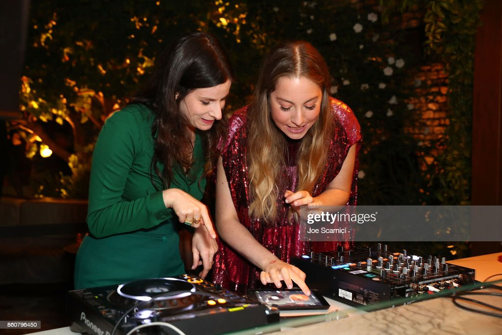Este Haim and Sasha Spielberg play music at NYLON's It Girl Party at The Highlight Room at the Dream Hollywood on October 12, 2017 in Hollywood, California.
