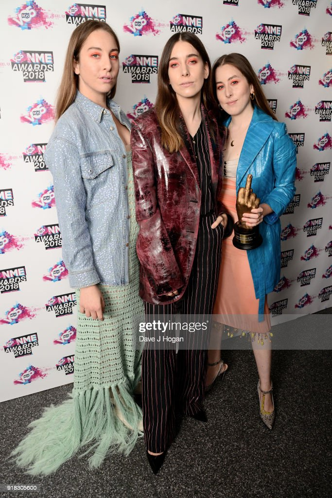 Este Haim, Danielle Haim and Alana Haim of Haim pose in the winners room with the award for Best International Band at the VO5 NME Awards held at Brixton Academy on February 14, 2018 in London, England.