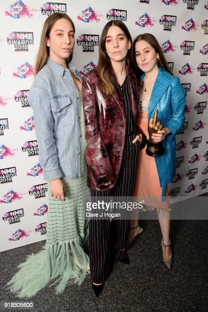 Este Haim Danielle Haim and Alana Haim of Haim pose in the winners room with the award for Best International Band at the VO5 NME Awards held at...