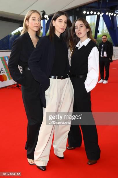 Este Haim, Danielle Haim,and Alana Haim of Haim attend The BRIT Awards 2021 at The O2 Arena on May 11, 2021 in London, England.
