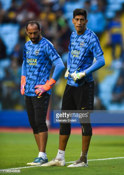Esteban Andrada and Marcos Diaz of Boca Juniors looks on during a warm up before a group G match between Boca Juniors and Deportes Tolima as part of...