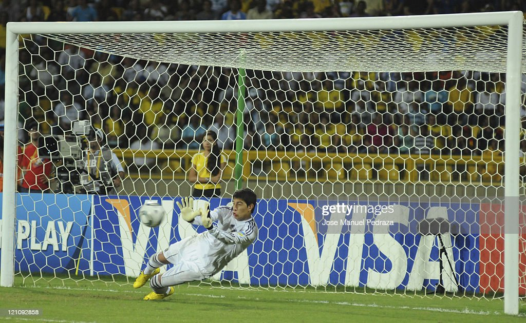 Esteban Andrada, from Argentina, stops a penalty kick in the penalty shoot out the match between Argentina and Portugal as part of the U20 World Cup Colombia 2011 at Jaime Moron Stadium on August 13, 2011 in Cartagena, Colombia.