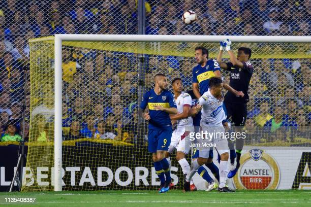 Esteban Andrada goalkeeper of Boca Juniors punches the ball during a group G match between Boca Juniors and Deportes Tolima as part of Copa CONMEBOL...