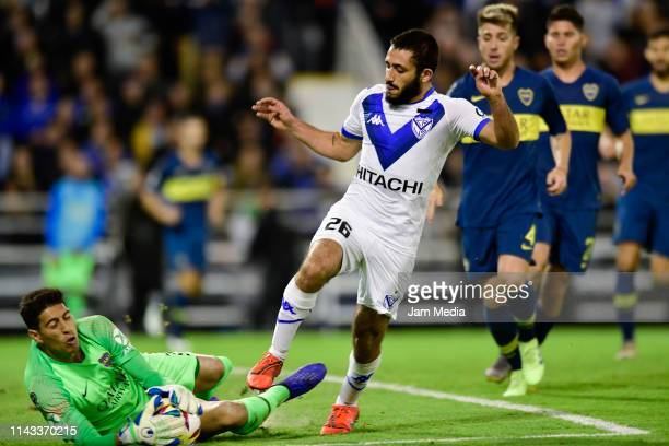 Esteban Andrada of Boca Juniors controls the ball under pressure from Matias Vargas of Velez Sarsfield during a first leg quarter final match between...