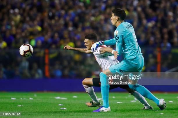 Esteban Andrada of Boca Juniors fights for the ball with Matias Suarez of River Plate the Semifinal second leg match between Boca Juniors and River...