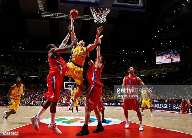 Esteban Batista of Maccabi Elite is blocked by Artem Zabelin and Marcus Goree of CSKA Moscow during the Euroleague Final Four final basketball match...
