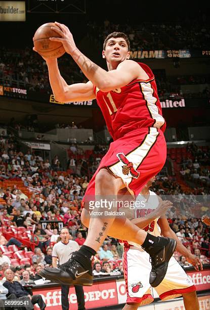 Esteban Batista of the Atlanta Hawks grabs a rebound against the Miami Heat on March 4 2006 at American Airlines Arena in Miami Florida NOTE TO USER...