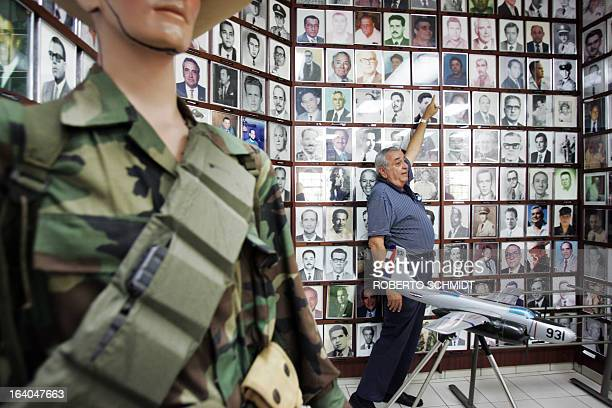 Esteban Bovo the President of the Association of Combatants of the Bay of Pigs and former fighter pilot points to photographs of members of the...