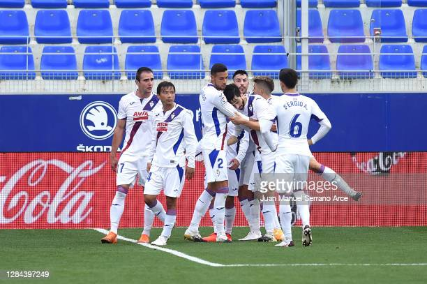 Esteban Burgos of SD Eibar celebrates with teammates after scoring his team's first goal during the La Liga Santander match between SD Huesca and SD...