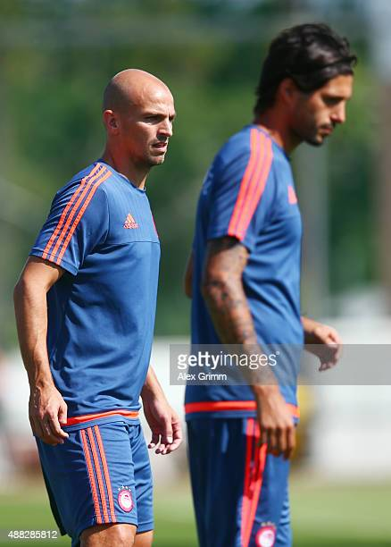 Esteban Cambiasso and Alejandro Dominguez attend a Olympiacos FC training session ahead of their UEFA Champions League Group F match against Bayern...