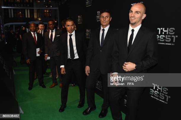Esteban Cambiasso and Javier Zanetti arrive on the green carpet for The Best FIFA Football Awards at The London Palladium on October 23 2017 in...
