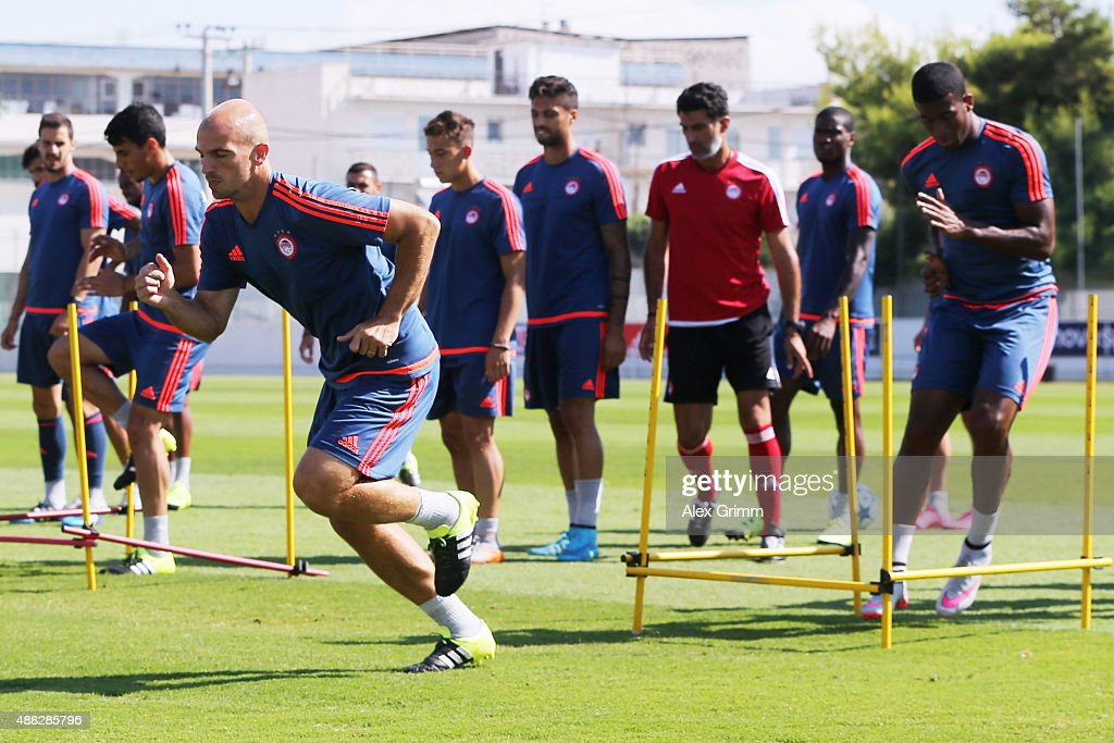 Esteban Cambiasso and team mates exercise during a Olympiacos FC training session ahead of their UEFA Champions League Group F match against Bayern Muenchen at Olympiacos training ground on September 15, 2015 in Athens, Greece.
