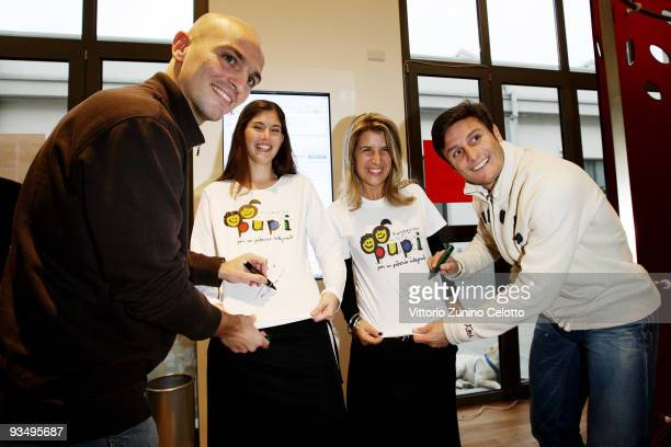 Esteban Cambiasso Claudia Cambiasso Paula Zanetti Javier Zanetti attend PUPI shop opening on November 27 2009 in Milan Italy The PUPI is a charity...