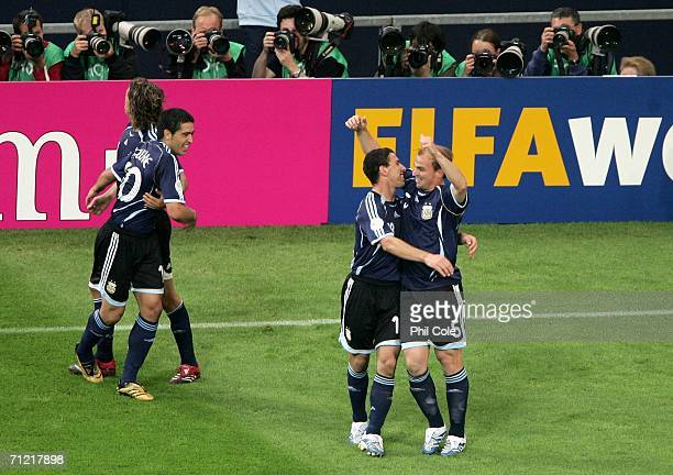 Esteban Cambiasso of Argentina is congratulated by his team mates after scoring the second goal during the FIFA World Cup Germany 2006 Group C match...