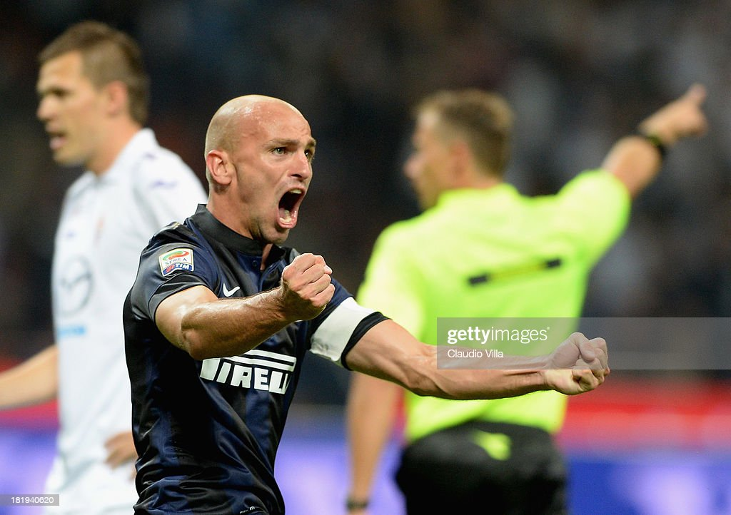 Esteban Cambiasso of FC Inter celebrates scoring the first goal during the Serie A match between FC Internazionale Milano and ACF Fiorentina at Giuseppe Meazza Stadium on September 26, 2013 in Milan, Italy.