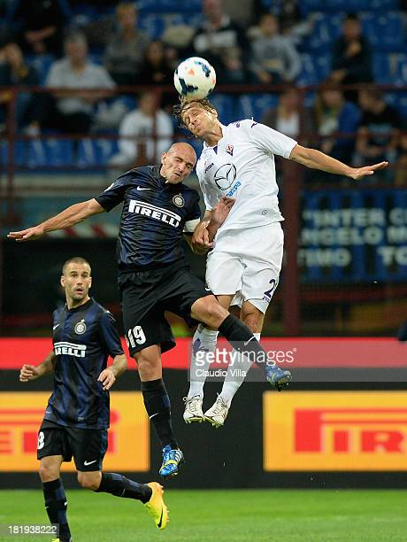 Esteban Cambiasso of FC Inter Milan and Massimo Ambrosini of ACF Fiorentina compete for the ball during the Serie A match between FC Internazionale...