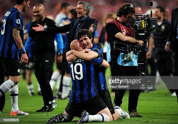 Esteban Cambiasso of Inter Milan celebrates their team's victory with Diego Milito at the end of the UEFA Champions League Final match between FC...