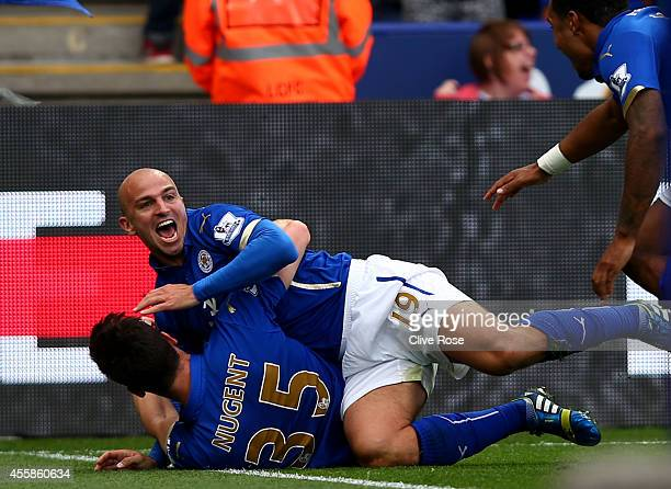 Esteban Cambiasso of Leicester City celebrates with David Nugent of Leicester City after scoring his team's third goal during the Barclays Premier...