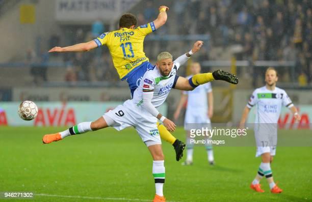 Esteban Casagolda of OH Leuven in action with Louis Vertraete of WaaslandBeveren during the Belgian First Divison A Europa League Playoffs tie...