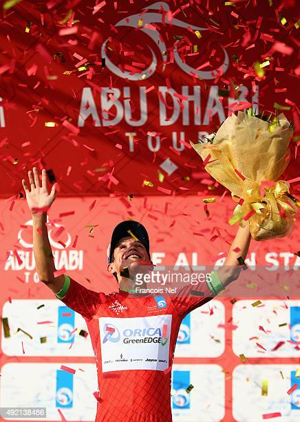 Esteban Chaves of Colombia and Orica Greenedge wearing the general time classification red jersey celebrates on the podium after stage three of the...