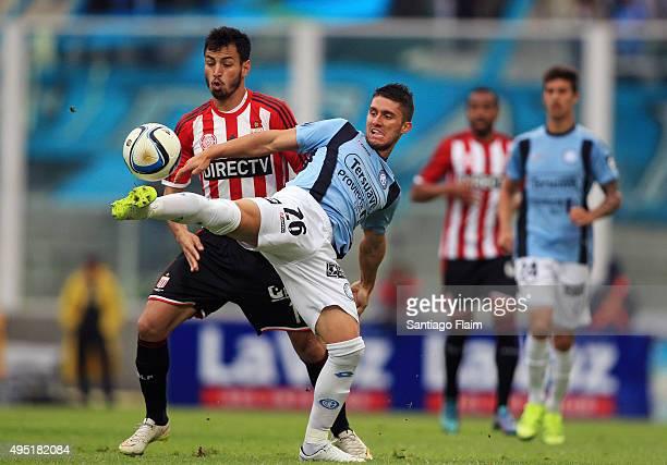 Esteban Espindola Lopez of Belgrano fights for the ball with Juan Sanchez Miño of Estudiantes during a match between Belgrano and Estudiantes as part...