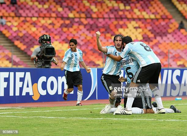 Esteban Espindola of Argentina celebrates with his team mates after scoring his team's first goal during the FIFA U17 World Cup Group A match between...