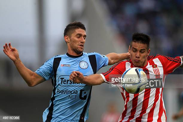 Esteban Espindola of Belgrano fights for the ball with Carlos Auzqui of Estudiantes during a match between Belgrano and Estudiantes as part of 29th...