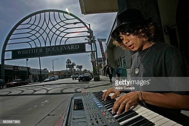 Esteban Flores a self taught musician practices his keyboard as he waits for a bus on Whittier Boulevard in East Los Angeles May 14 2008 near the...