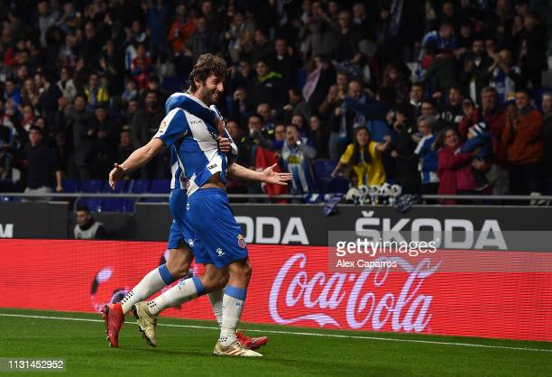 Esteban Granero of Espanyol celebrates with team mates after scoring the opening goal during the La Liga match between RCD Espanyol and SD Huesca at...